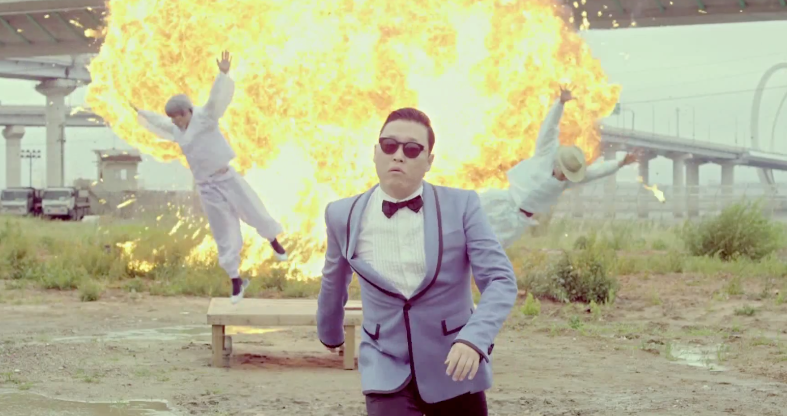 psy_walks_away_from_an_explosion